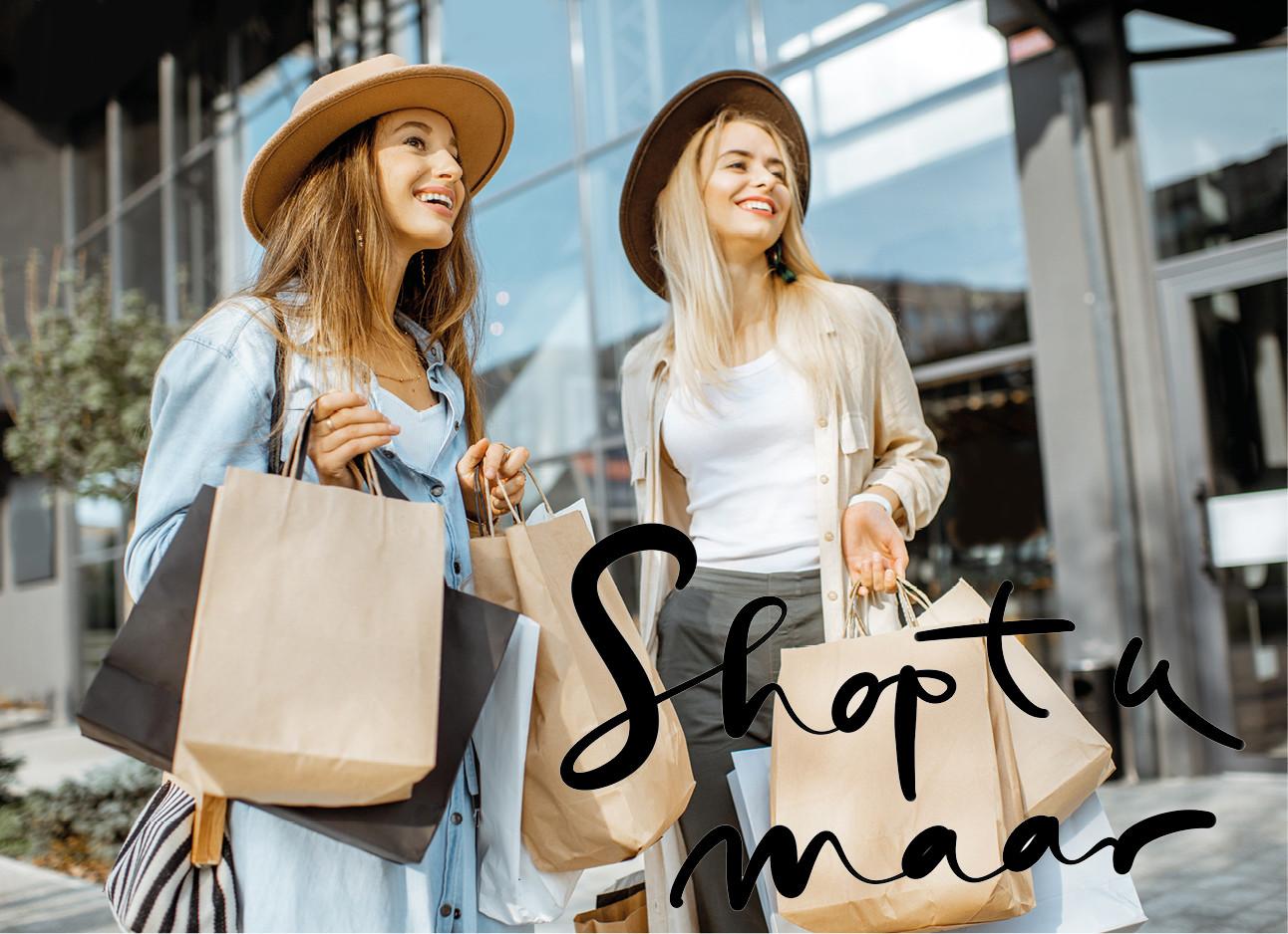 meiden die samen aan het winkelen zijn