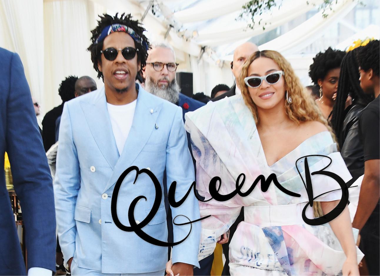 beyonce en Jay z lopend bij een feestje met zonnebril op