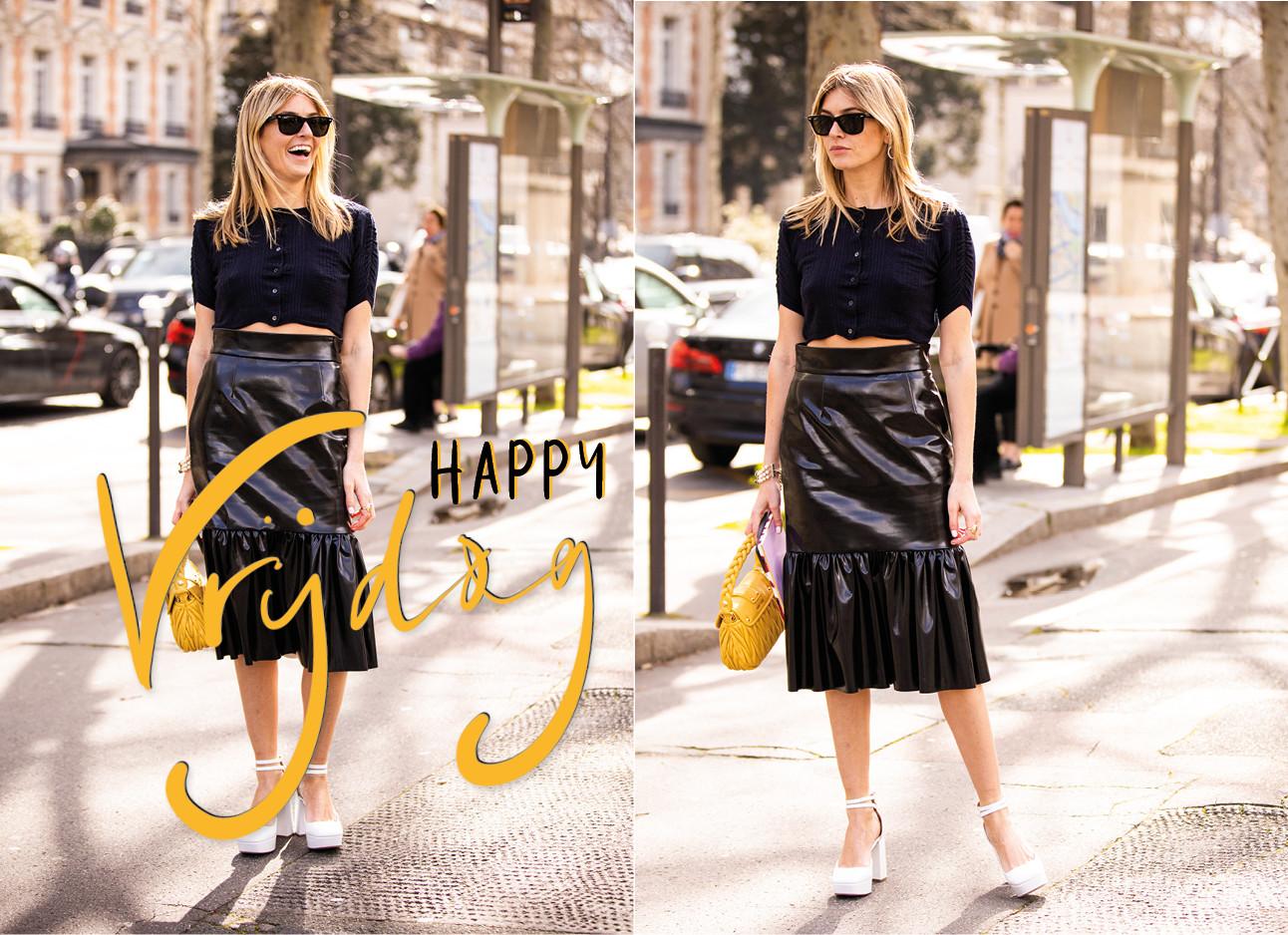 Look of the day Camille Charrière lopend over straat in een zwart outfit met witte hakken en gele tas