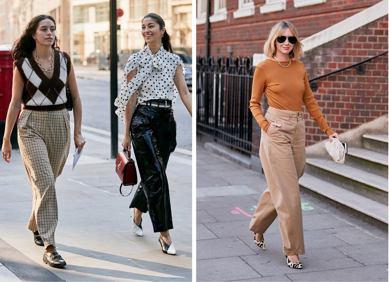 Beelden van fashion week met 2 meiden die bruine broeken dragen met een zwarte top