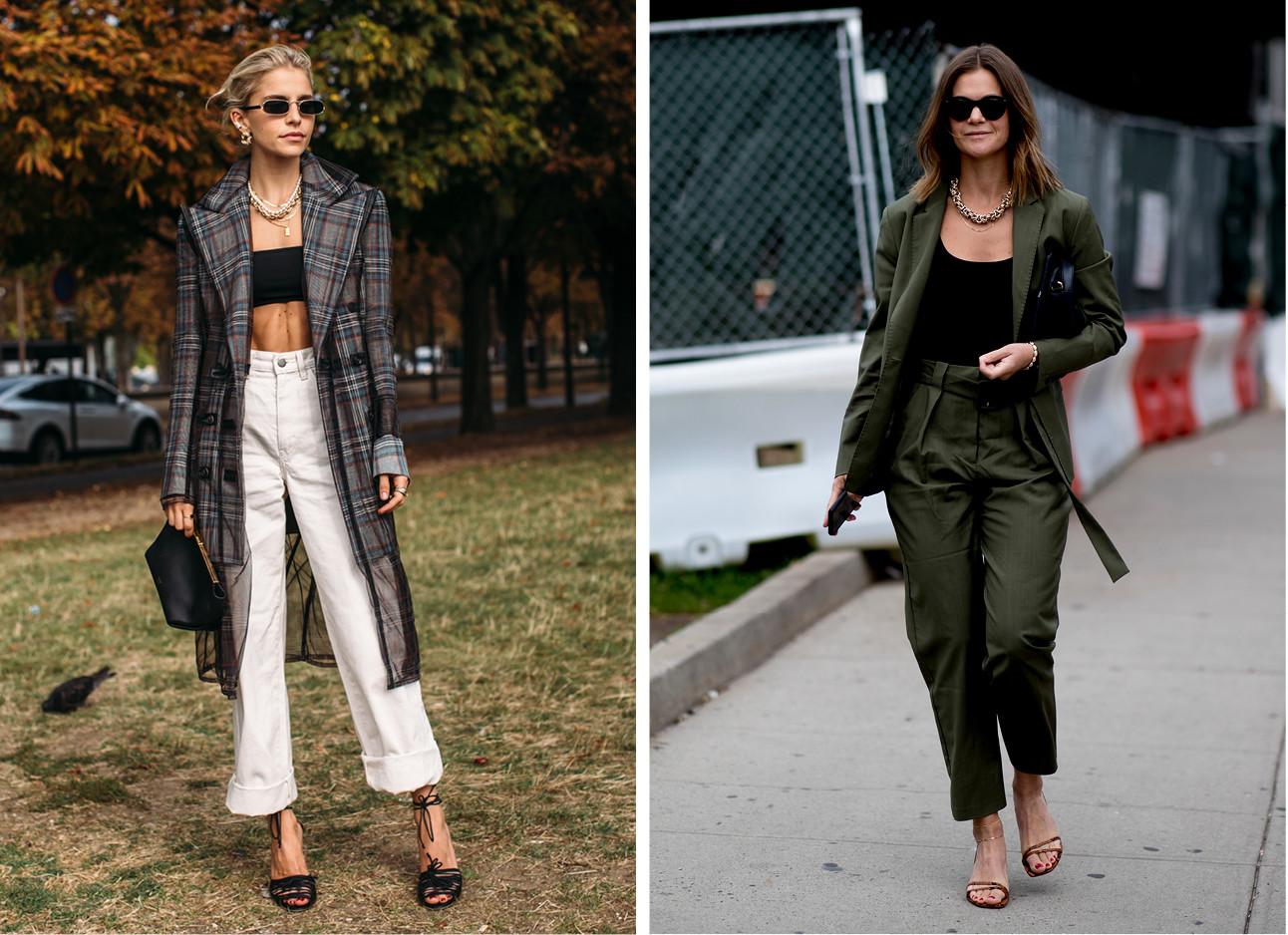 een draagt een witte broek met een zwarte bandeau top en een geruite jas de andere draagt een donker groen pak en een zwarte top