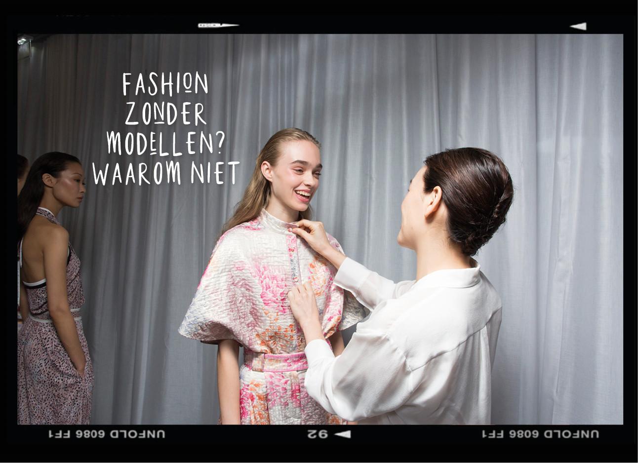 een model dat aangekleed wordt door een styliste