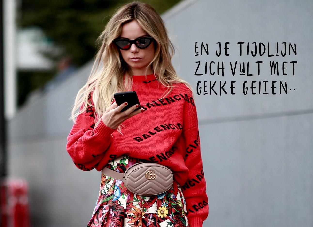 vrouw rode outfit zonnebril mobiel
