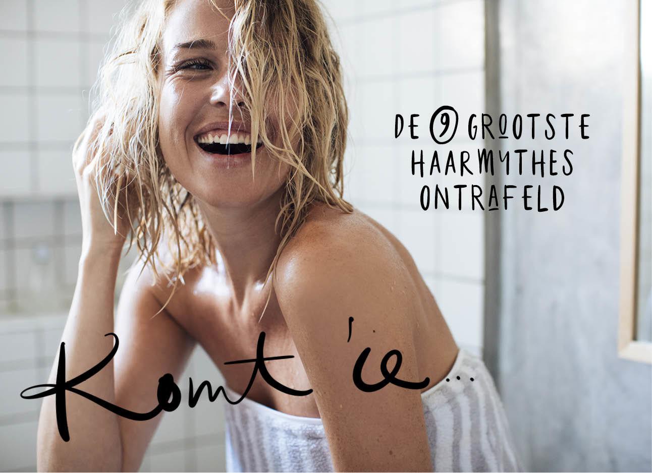 blonde vrouw na het douchen in een handoek, nat haar, lachend, de 9 grootste haarmuthes ontrafeld, komt ie