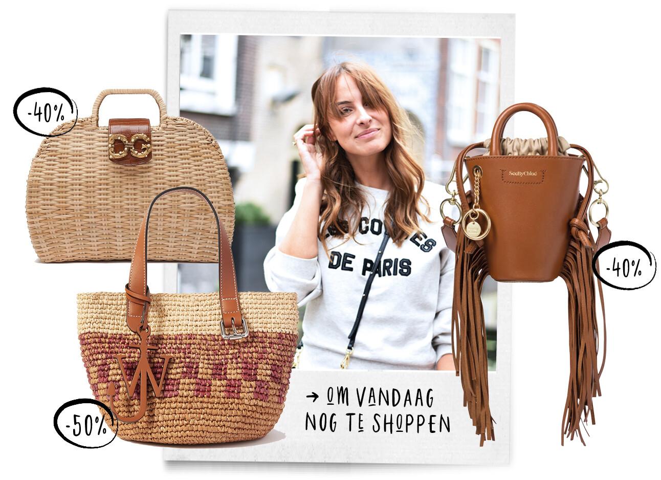 lilian brijl lachend met designer tassen om haar heen in de sale
