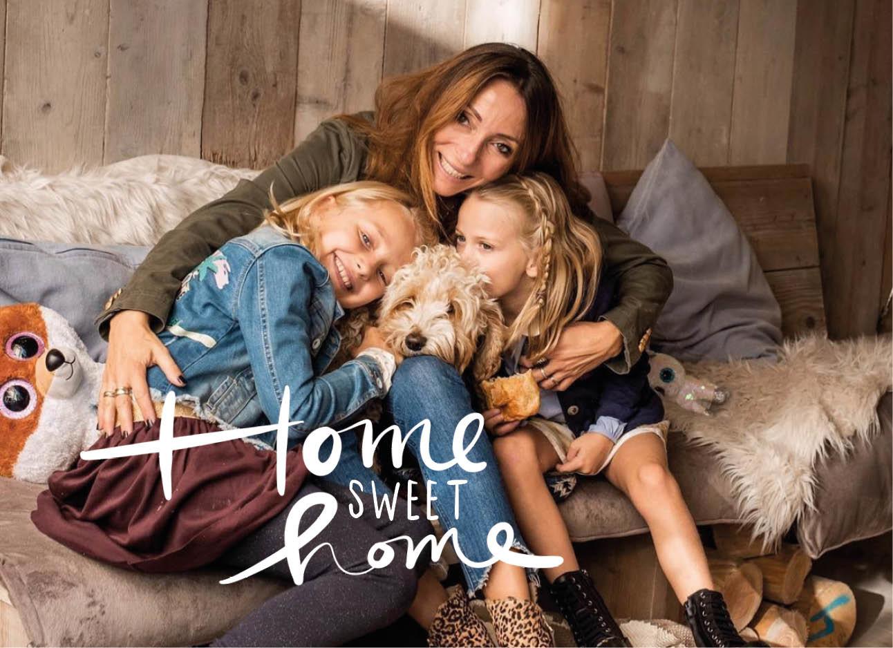 May-britt met kids knuffelend in haar tuinhuisje