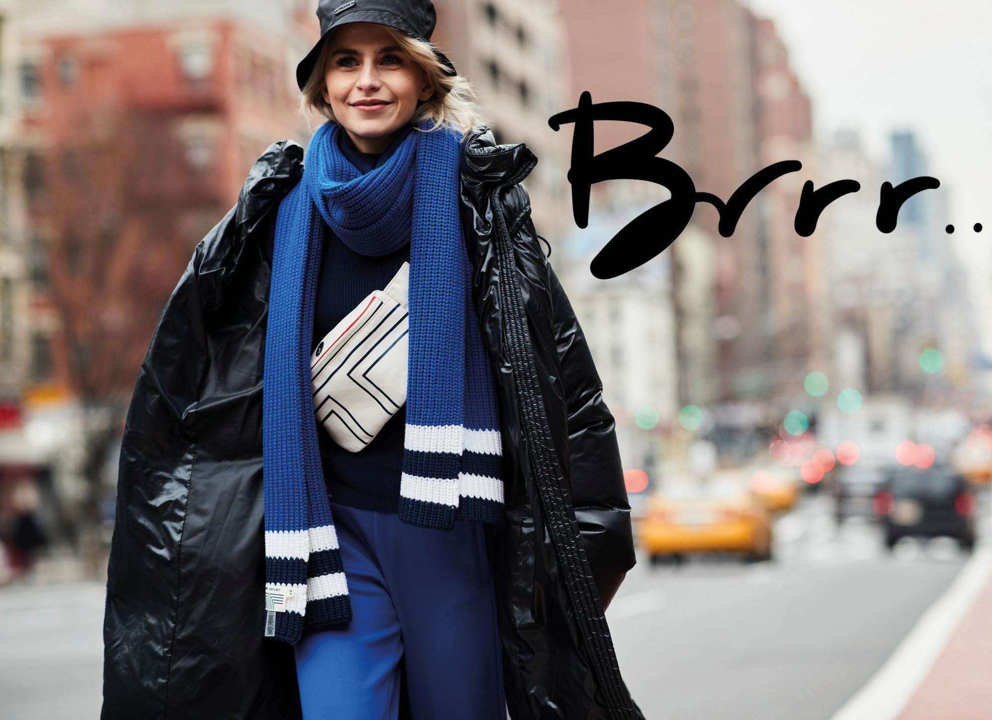 meisje met hoedje sjaal en dikke jas in de winter