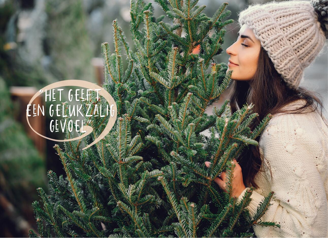 vrouw met kerstboom