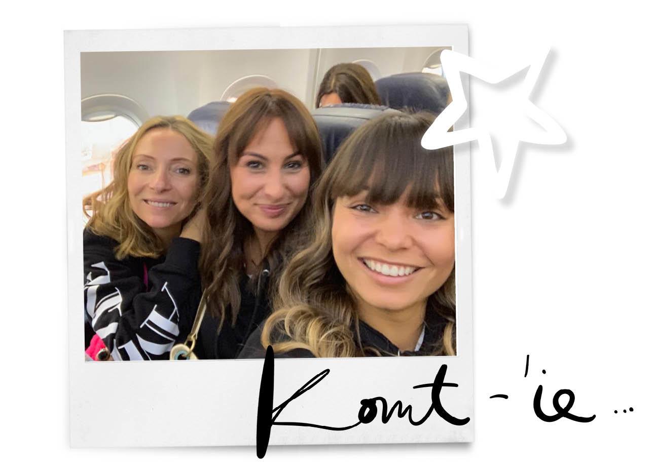 kiki may lil in vliegtuig in zwarte trui