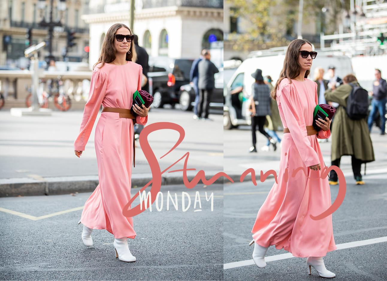 Erika Boldrin in een roze satijnen jurk over straat met witte hakken aan