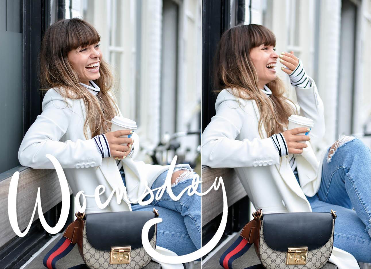 kiki die ergens op zit met naast zich een gucci tas, ze daagt een wit jasje en een spijkerbroek