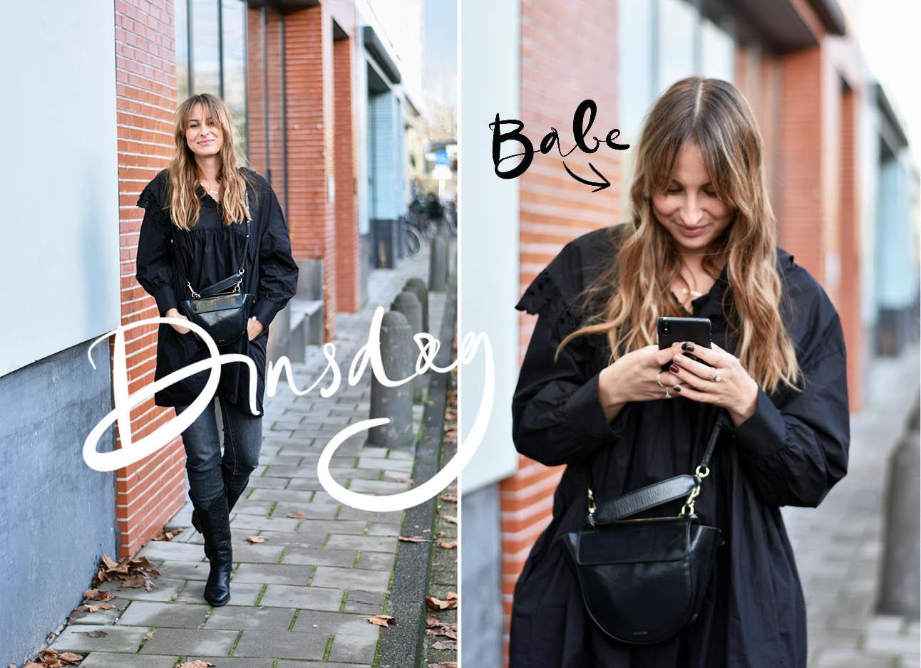 Lilian Brijl look of the day lachend met wandler tas boots en zwarte jurk aan