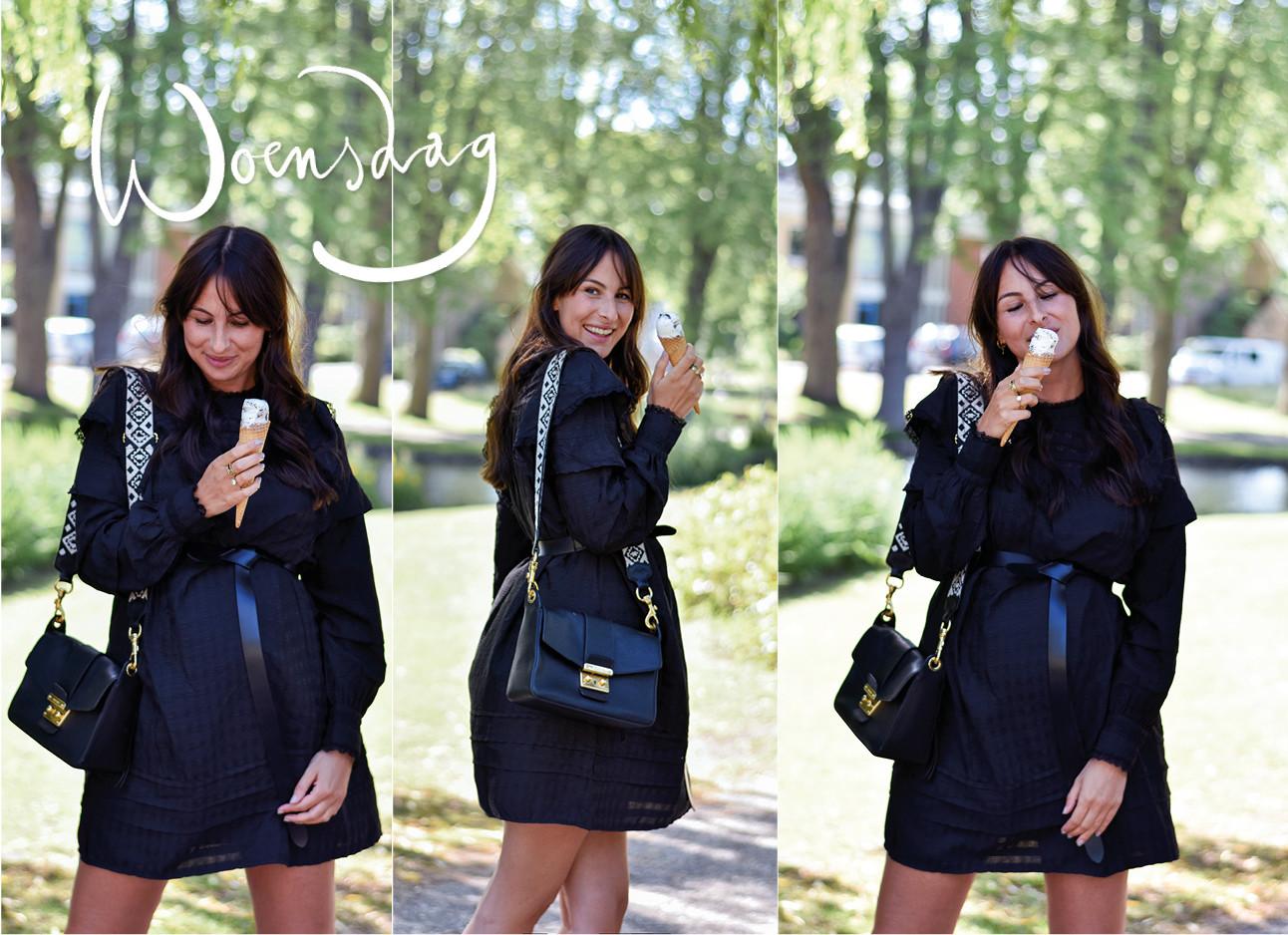 Lilian brijl lachend op straat met een zwart jurkje aan en een ijsje