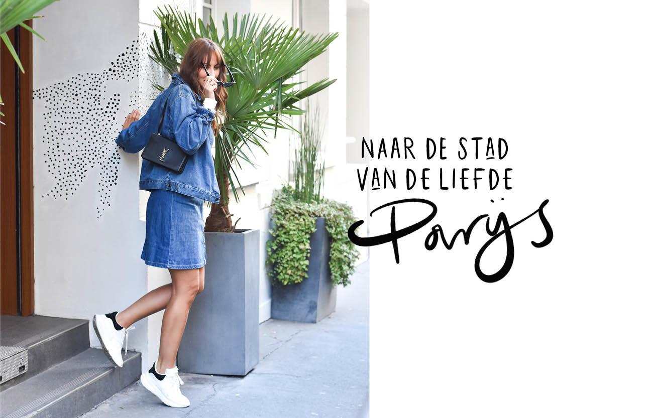 lilian brijl in een spijkerjasje met een Yves saint laurent tas onder haar arm lopend en lachend door Parijs