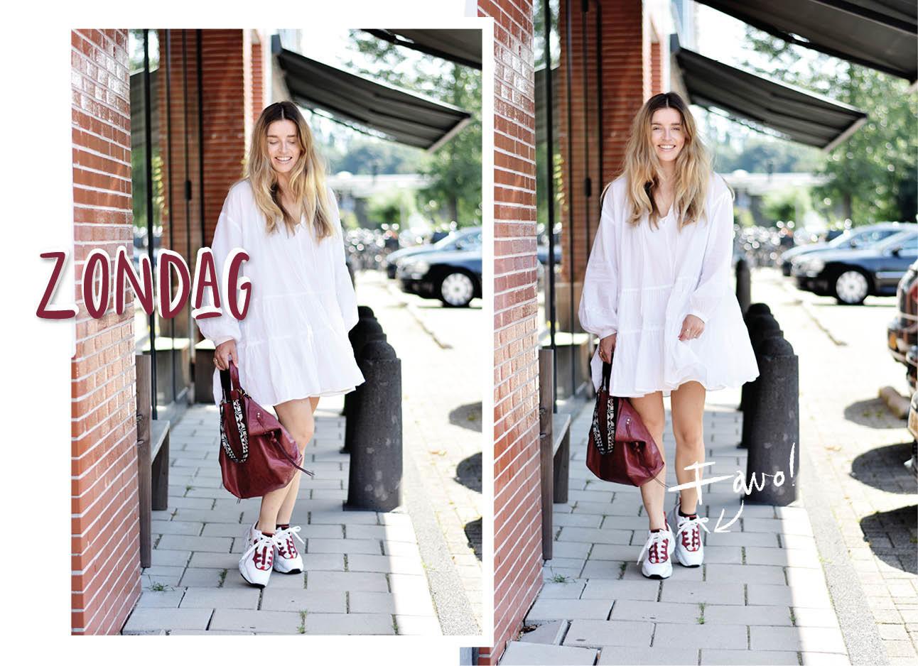 lotte in witte jurk en sneakers met rode isabel marant tas