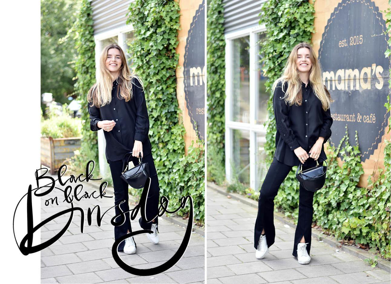 Lotte van Scherpenzeel lachend bij cafe Mama's in zwarte kleding broek flare met witte sneakers