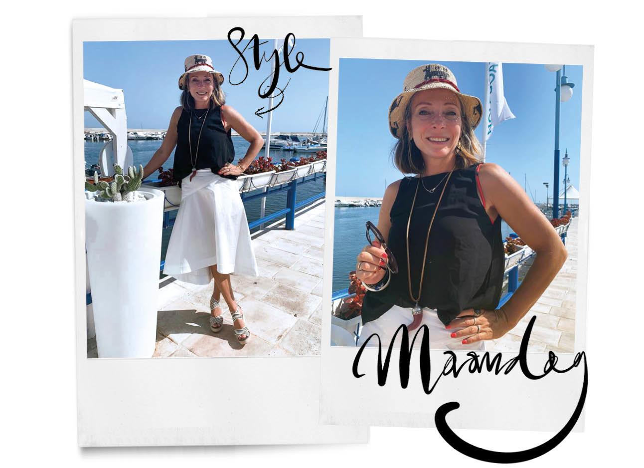 may met hoed, zwarte top en witte rok van pauw met sleehakken in italie
