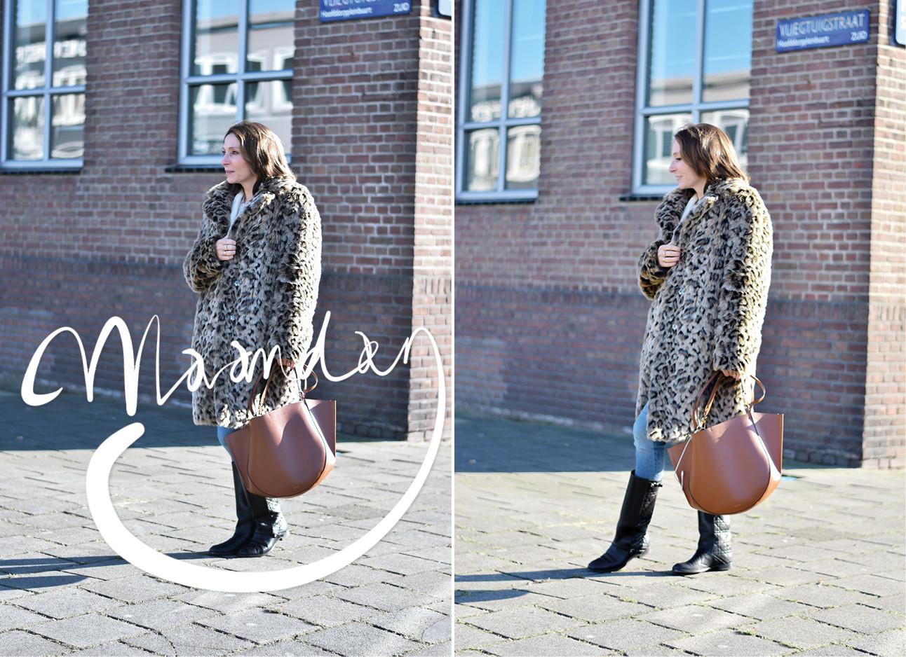 Vrouw in een lange bontjas met panterprint
