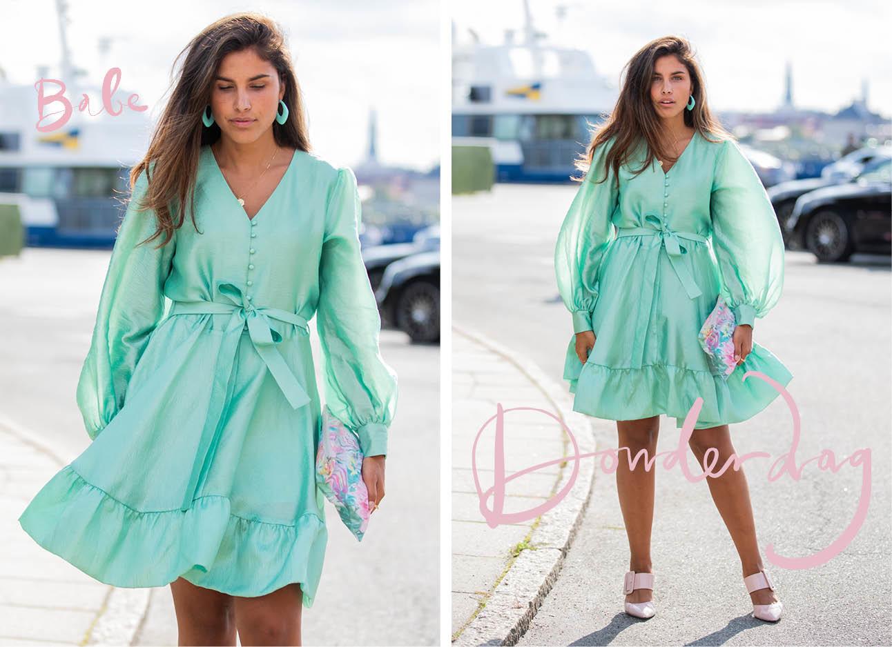 KAE SUTHERLAND lachend in een zomerse jurk