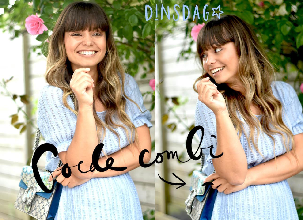 kiki duren in een blauwe zomerjurk met een guccitas met print, lachend