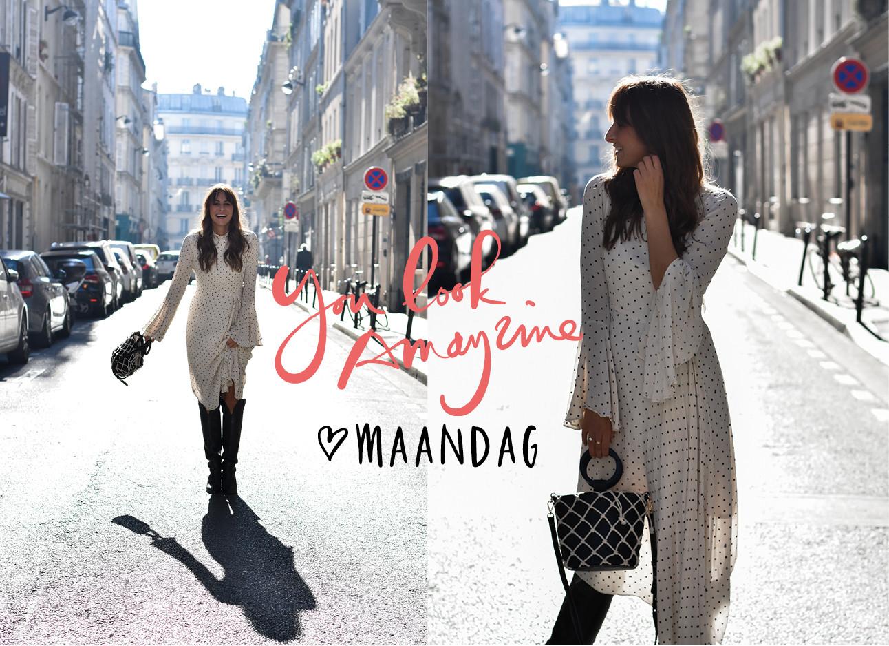 lil in de straten van parijs in een wit met zwart gestipte jurk van essentiel antwerp en een tas van mango en boots van &other stories over haar knie