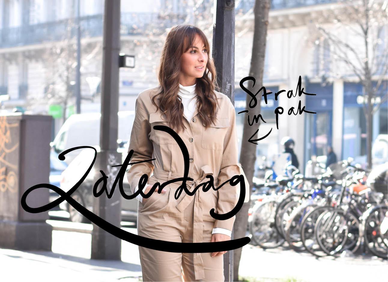 Lilian brijl lopend in parijs met een beige pak aan en een wit truitje eronder