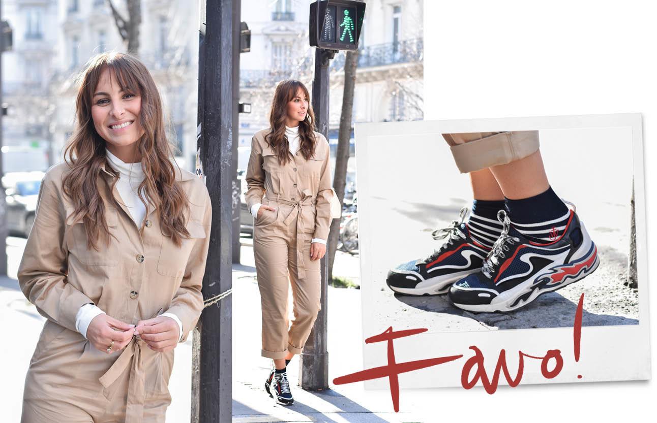 Lilian brijl lopend in parijs met een beige pak aan en een wit truitje eronder en sandro rode met blauwe gympen