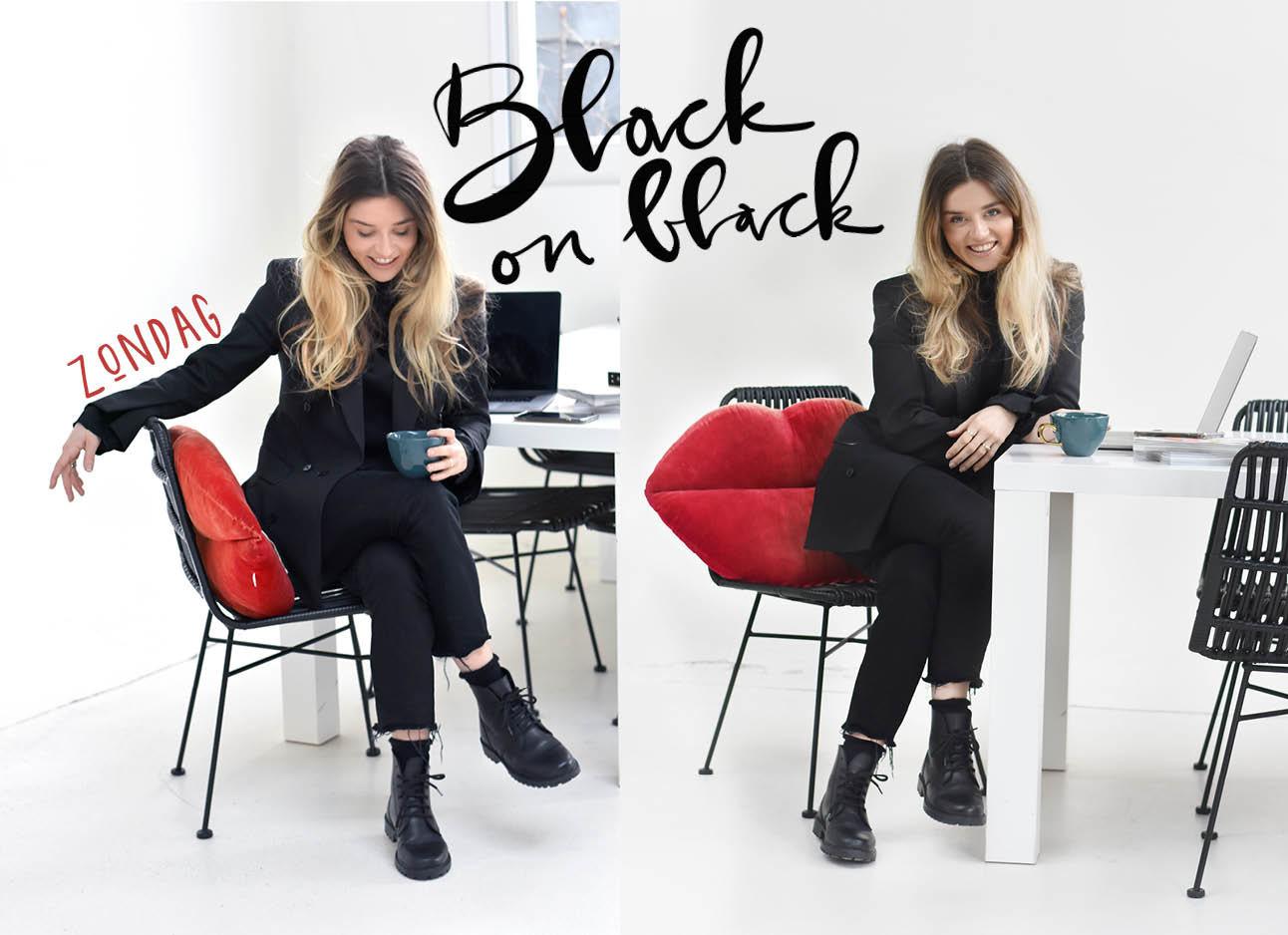 lotte in zwarte broek zwart shirt zwarte boots met een rood kussen op een zwarte stoel