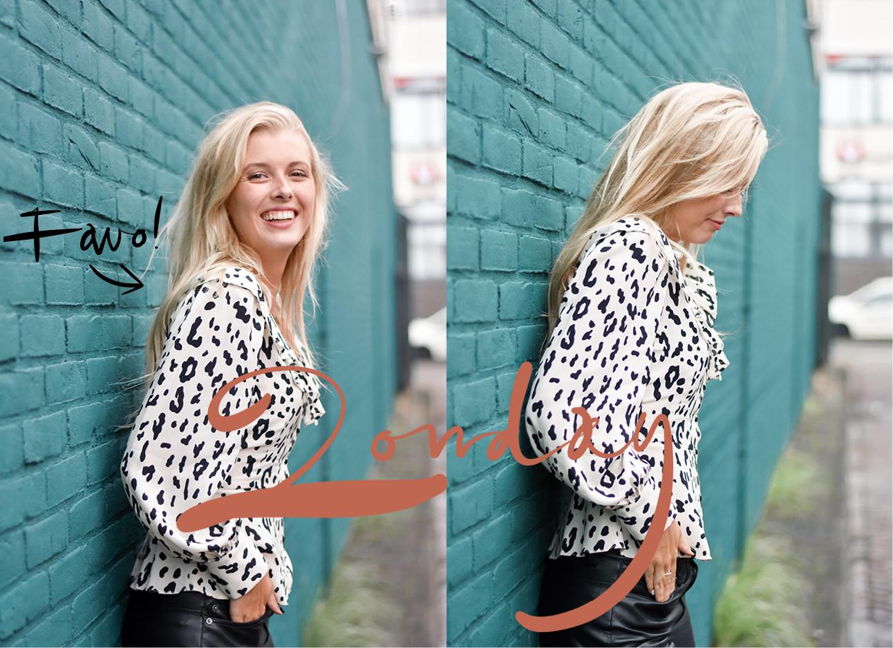 Annabelle die in een witte luipaard blouse tegen een mint blauwe muur leunt