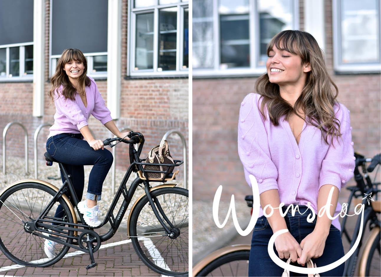 vrouw in een paars vest op de fiets
