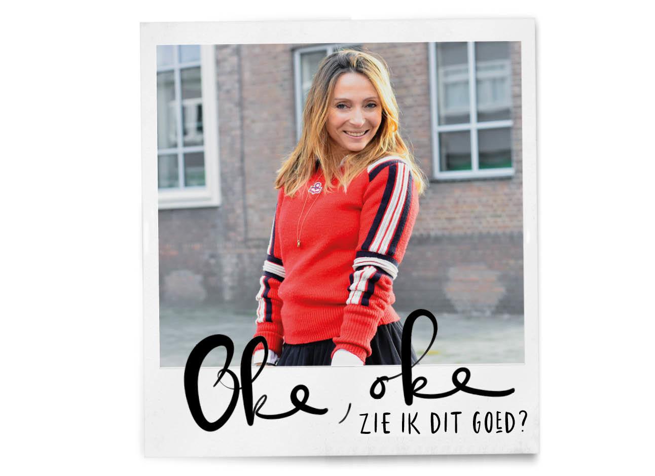may-britt lachend op de foto met een rode isabel marant trui aan buiten in de winter