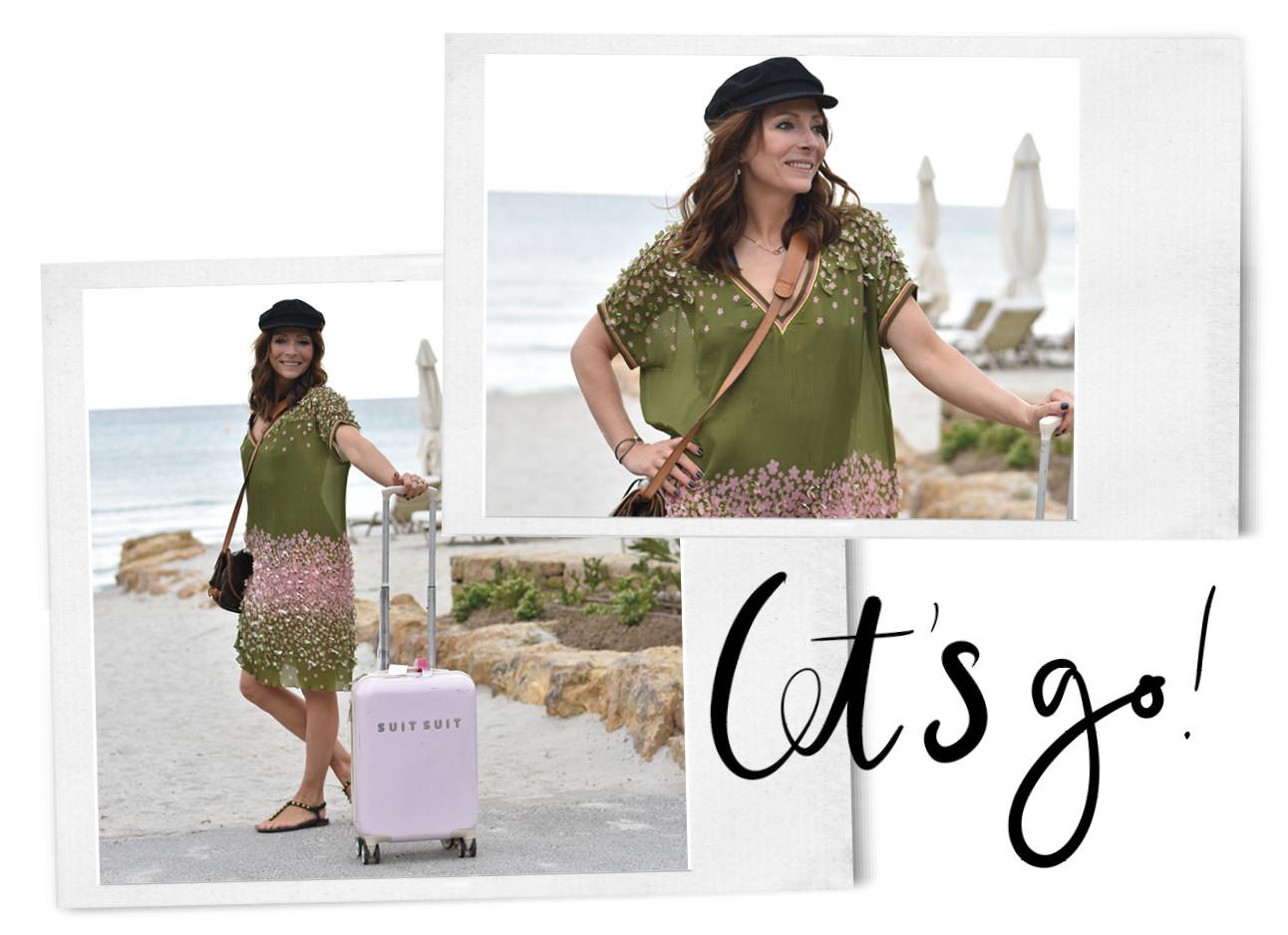 May-Britt in Griekenland met een suitsuit koffer