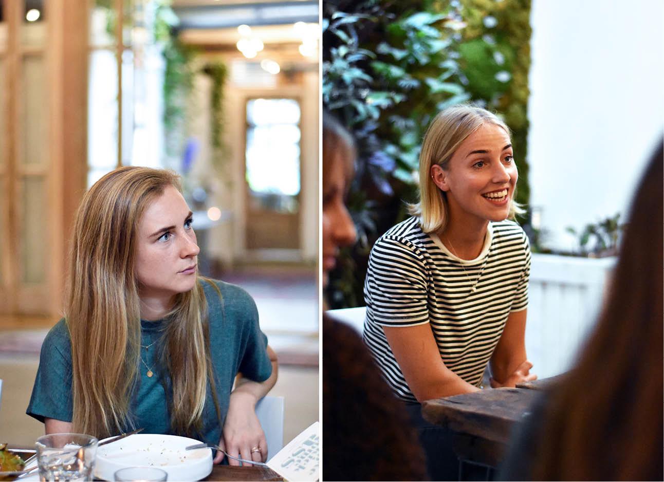 Beelden van meiden in een restaurant die aandachtig luisteren naar een presentatie