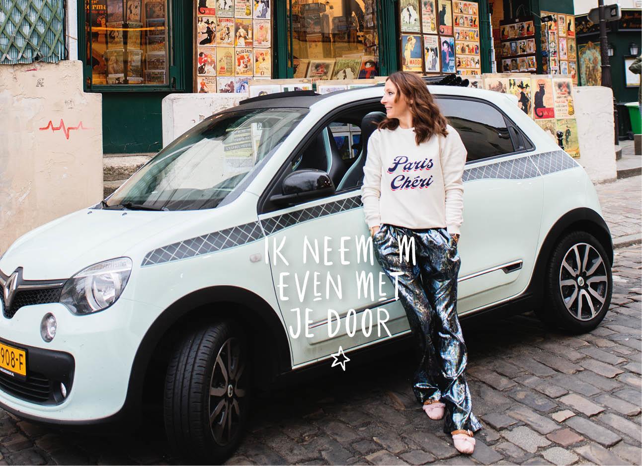 May bij haar Renault in Parijs