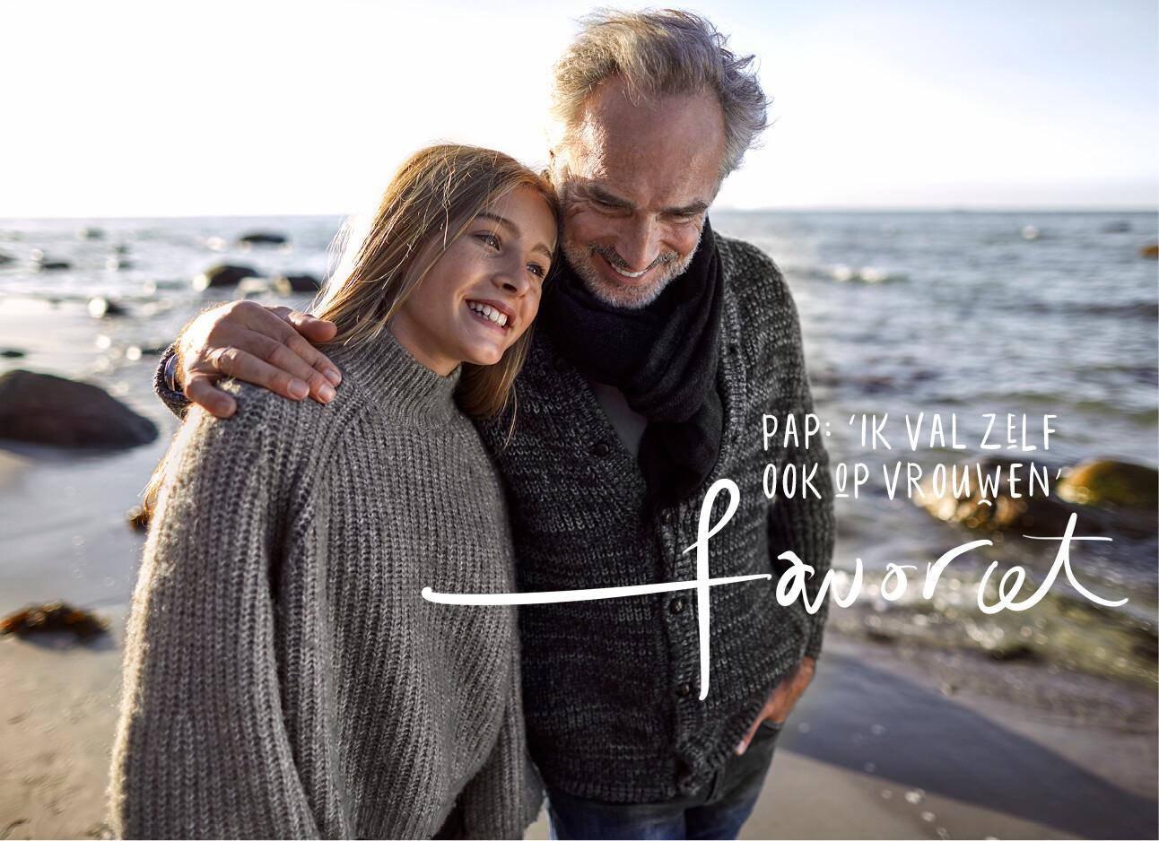 dochter lopend met vader over het strand