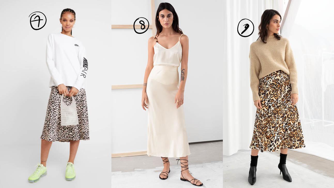 er staan 3 meiden, de ene draagt een dierenprint rok met een witte top, eentje draagt een witte rok en een witte top, en de laatste een dienrenprint rok met een beige top