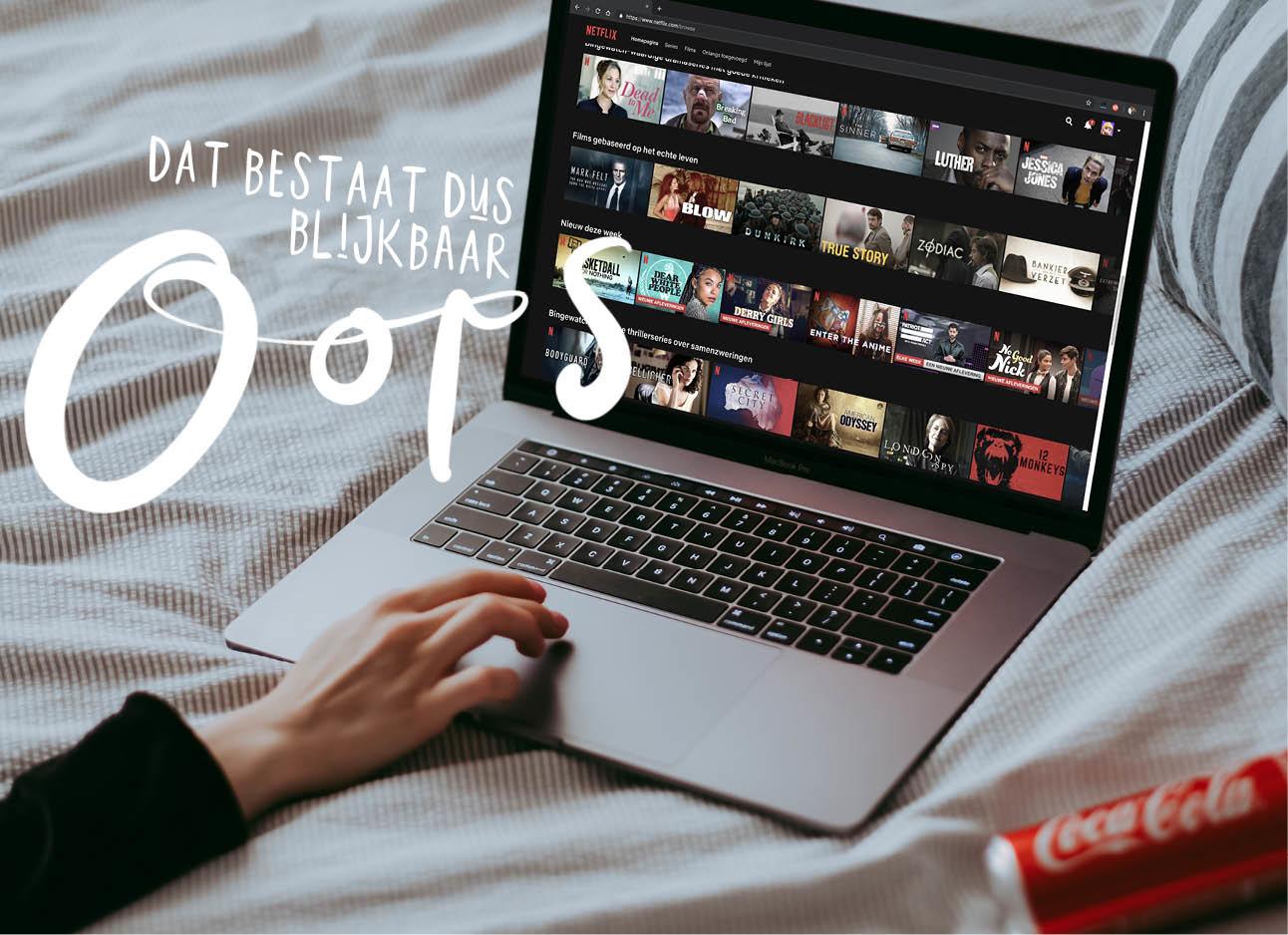 netflix kijken op laptop met blikje cola op bed