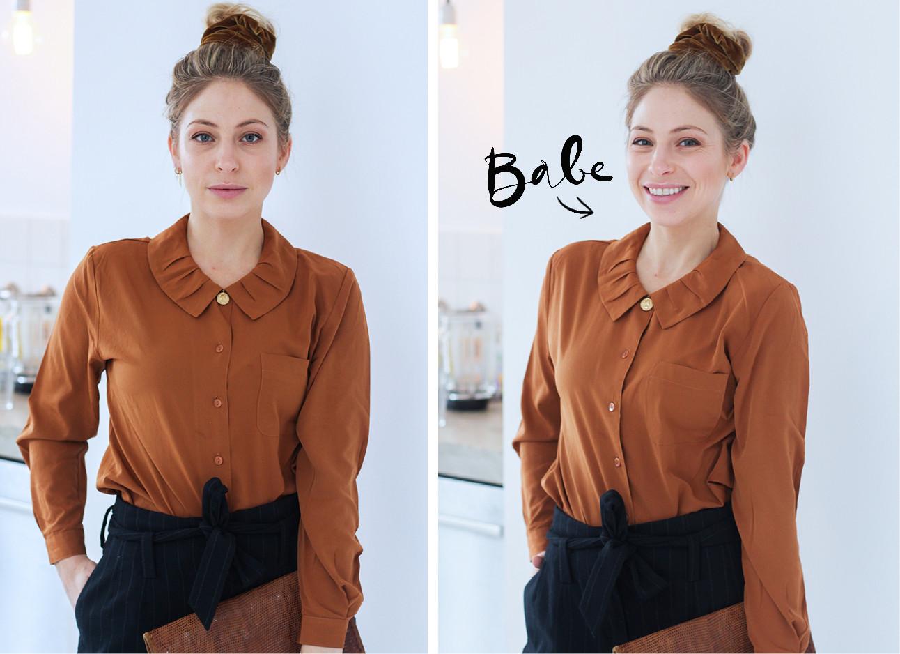 sarah chronis lachend met een bruin blouse aan het knotje op haar hoofd