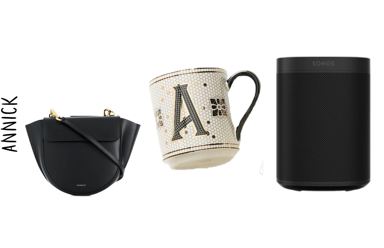 een zwarte tas met een wittemok en een zwarte bok