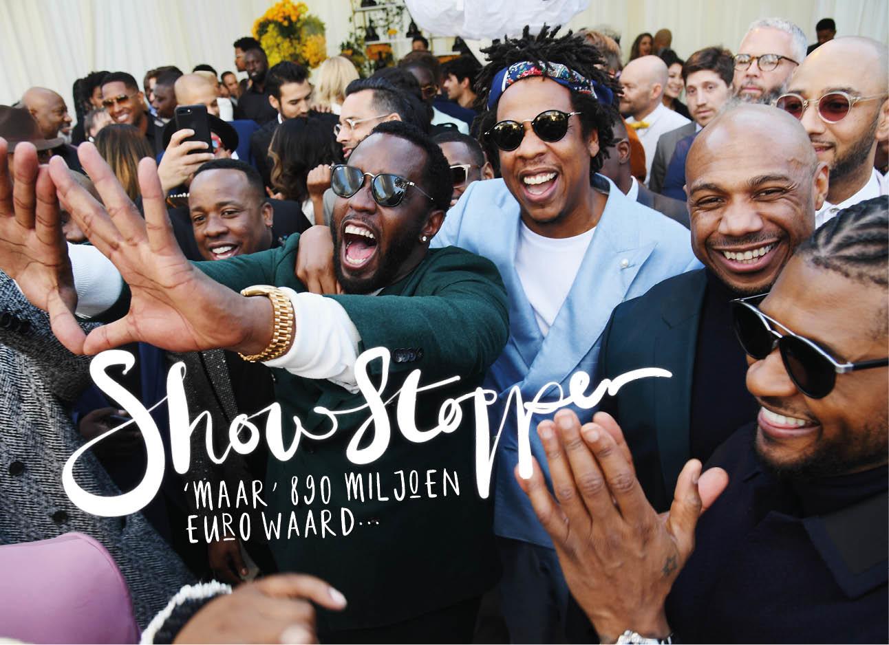 Jay z lachend met Usher en andere rappers op de rode loper