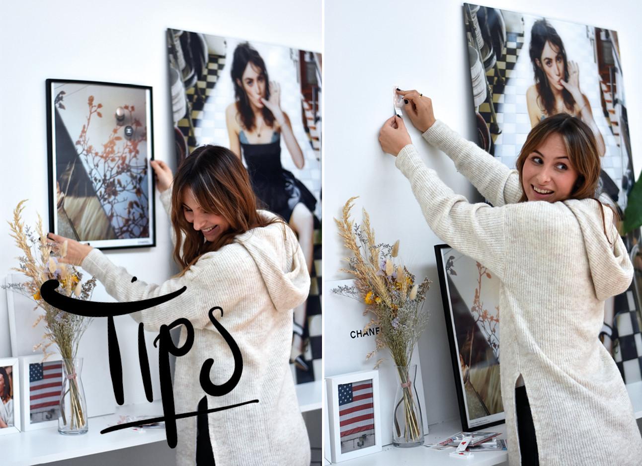 Lilian die een beeld aan de muur ophangt met de tesa plak spijker