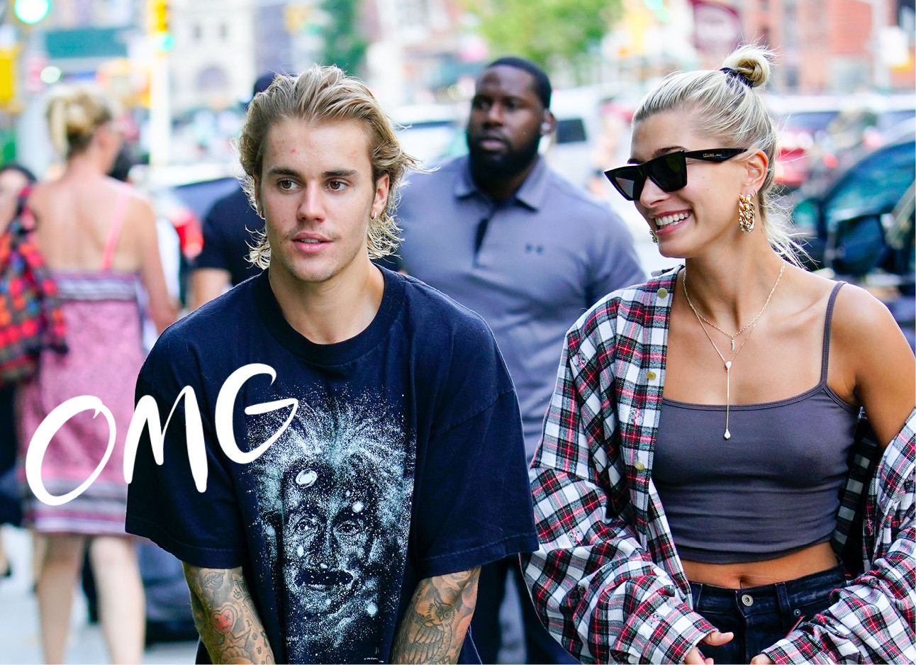 justin bieber wearing t-shirt haily baldwin bieber in grey top and blouse walking across the street