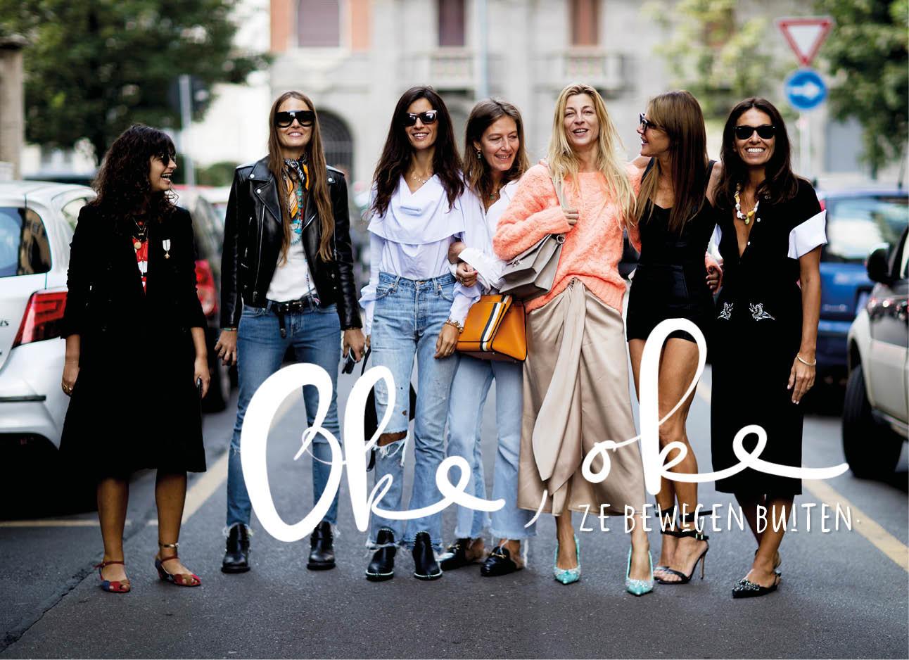 vrouwen wandelen op straat met een groep lachend jeans lange jurken gekleed streetwear