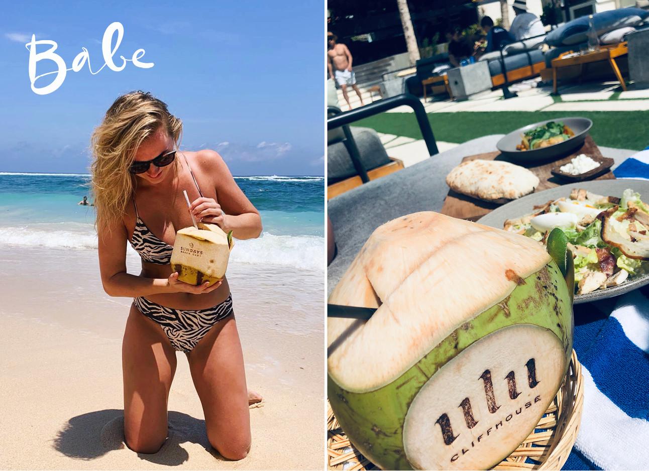 wieke op het strand met een kokosnoot
