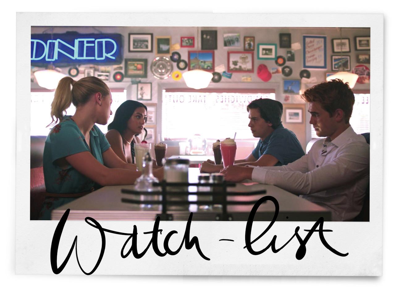 2 meiden en 2 jongens die aan een witte tafel zitten in een diner op de achtergrond een raam