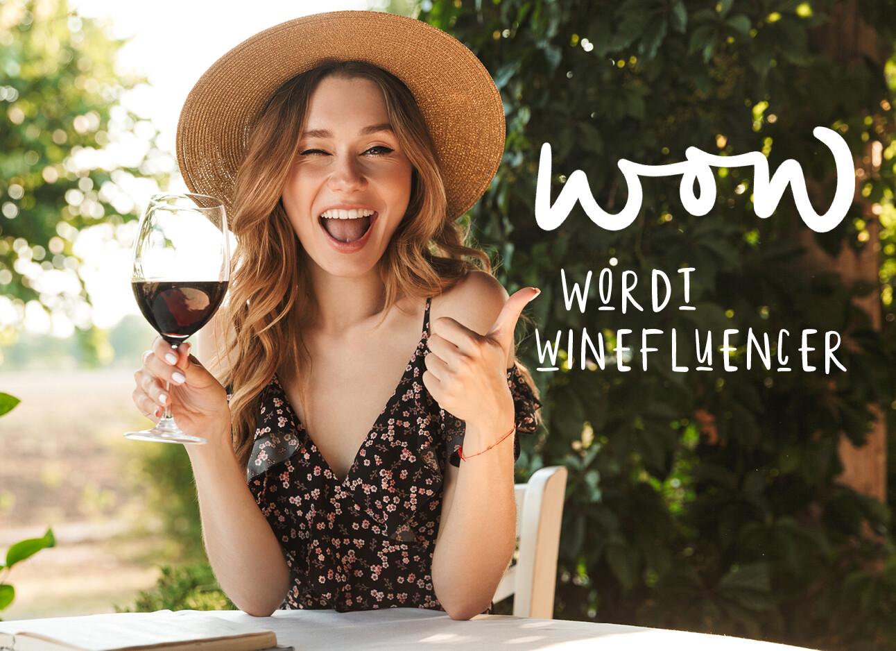 Vrouw met hoed aan de wijn