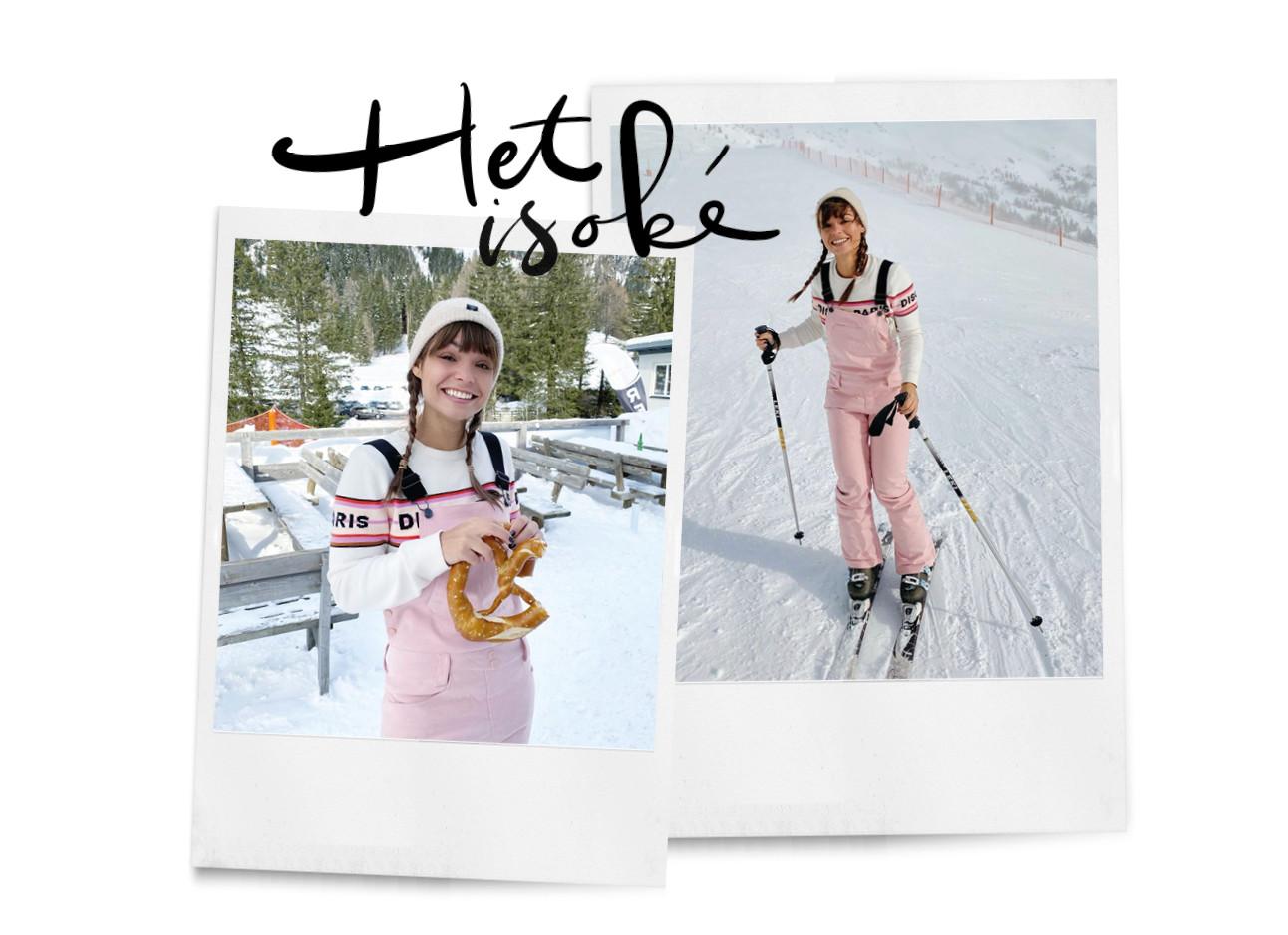 Vrouw roze trui aan het skiën